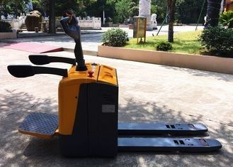 China Stand On Type 2500kg Electric Pallet Truck Jack Forklift With Folding Platform factory